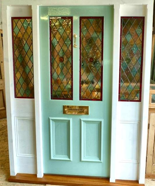 A Stained Gl Front Door With Frame And Sidelights