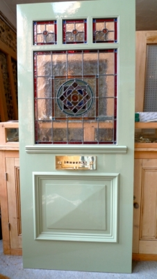 A painted Edwardian style door with letter plate