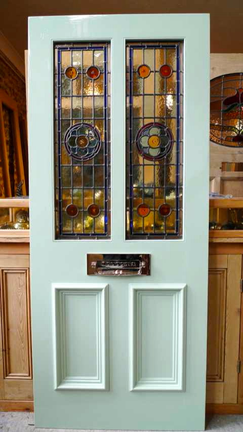 Victorian style 2 panel stained glass front door stained for Glass door in front of front door